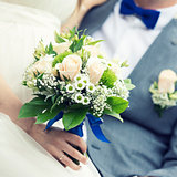 closeup of wedding bouquet in bride's hand