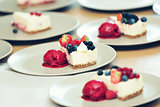 cheesecake with berries and sorbet on plates