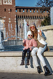 mother and daughter near Sforza Castle in Milan handwaving