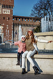 mother and child tourists near Sforza Castle having fun time