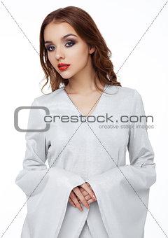 Beautiful fashion model wearing silver dress