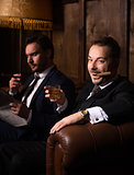 Rich businessmen with cigars