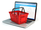 Online shopping e-commerce concept. Shopping basket on laptop ke