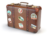 Retro suitcase beggage with travel stickers isolated on white ba