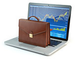 Stock market online business concept. Briefcase on laptop keyboa
