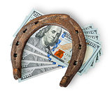 Old rusty horseshoe and money