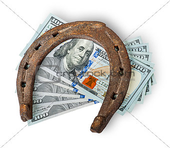 Old rusty horseshoe and money