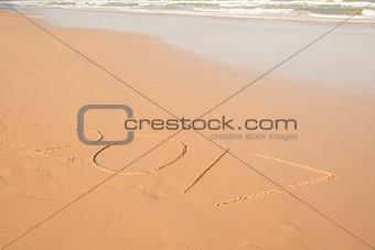 2017 text on sand beach