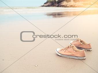 Canvas shoes on the sand beach