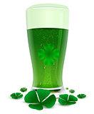 Green drink ale in high transparent glass. Green leaf quatrefoil clover symbol of St. Patricks Day