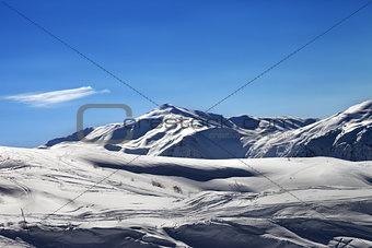 Off-piste ski slope in sunny evening