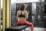 Athletic woman posing in locker-room