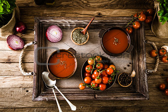 Tomato soup on wood
