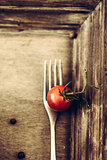 Fork and tomato