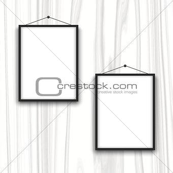 Blank frames on wood background