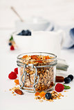 Healthy breakfast -  Homemade granola, honey, milk and berries