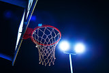 Basketball hoop on outdoor court at night