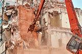 City house demolition with big hydraulic scissors