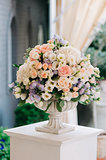 Beautiful wedding bouquet in stone vase, closeup