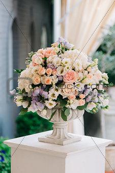 Beautiful wedding bouquet in stone vase, closeup
