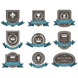 Emblems and badges with crowns and ribbons - award