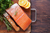 fresh red fish fillet of salmon with lemon and herbs
