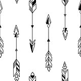 Seamless hand drawn geometric tribal pattern with arrows. Vector navajo design.