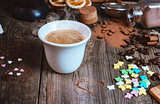 Porcelain cup with hot black coffee