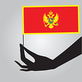 Hand with flag Montenegro