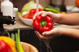 Washing fresh vegetables for a healthy salad - the red bell pepp