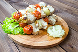 Skewered on wooden sticks tasty pork meat and vegetables mix,