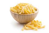 uncooked pasta caserecce in bowl