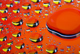 The Abstract orange red background with gradient color water drops on glass with reflection, big droplet, macro