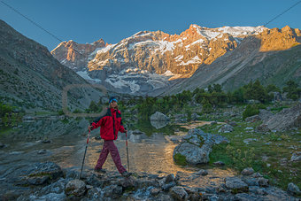 Tourist crossing mountain river