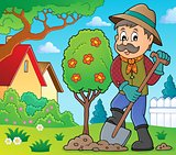 Gardener planting tree theme image 2