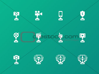Award icons on green background.
