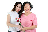Mother and daughter with carnation flower