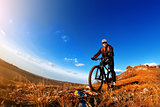 Mountain Bike and blue sky background. photographed on a fisheye lens