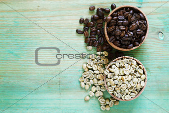 green and brown coffee beans on a wooden background
