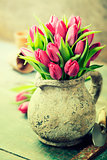pink tulips bouquet and garden tools