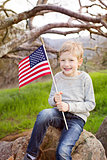 smiling boy with american flag