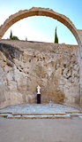 Panorama of the ruins the chapel in the castle Santa Barbara, with preserved arches and figures saints.