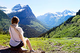 woman enjoying glacier national park