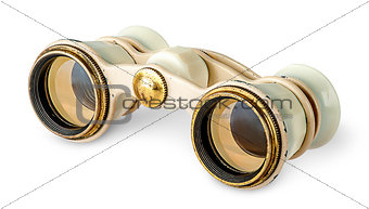 Old vintage pair of opera glasses in opposite directions