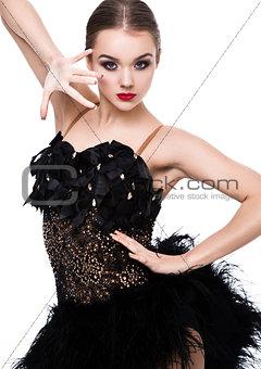 Beautiful ballroom dancer girl in elegant pose
