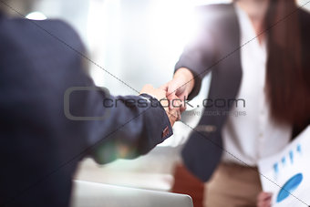 Close up view of business partnership handshake concept.Photo of two businessman handshaking process.Successful deal after great meeting.