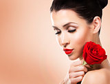 romantic woman holding red rose on beige background