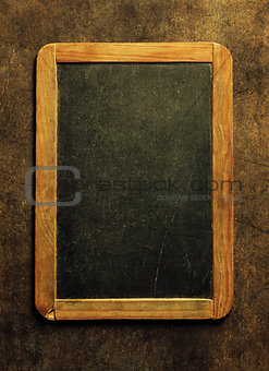 Blank chalkboard for your text. Top view over wooden table with