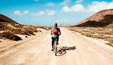 man riding a bike in La Graciosa, Canary Islands, Spain