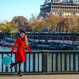 woman on embankment near Eiffel tower having fun time